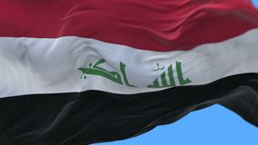 4k无缝的关闭伊拉克旗子缓慢挥动在风 包括的阿尔法通道 库存例证