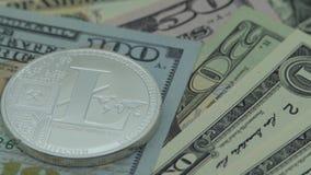 4K物理转动在美金的金属银色Litecoin货币 国际航空测量中心 影视素材