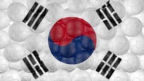 4K οι σφαίρες ποδοσφαίρου αφορούν κάτω ένα λευκό και διαμορφώνουν μια σημαία της Νότιας Κορέας απεικόνιση αποθεμάτων