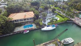 4k aerial drone camera architecture panorama view luxury swimming pool summer villa house in Miami Florida suburb avenue. Aerial drone camera architecture stock video
