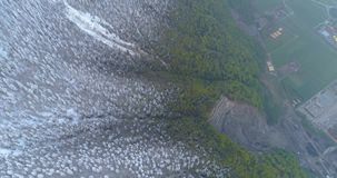 4k aerial drone Flying over the center of the quarry among the forest with snow