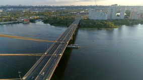4K Aerial drone footage. Fly over movkovsky bridge with floating ship. View on city at sunset. Aerial drone footage. Fly over movkovsky bridge with floating ship stock video
