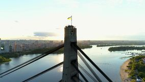 4K Aerial drone footage. Panorama trough moskovsky bridge pylon at sunset. Aerial drone footage. Panorama trough moskovsky bridge pylon at sunset stock video footage