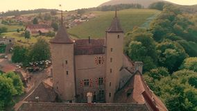 Magnificent 4k aerial drone panorama view on ancient medieval castle on green hill in province wine yard field landscape stock video