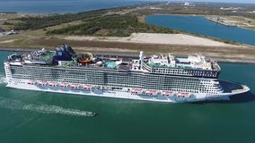 4k aerial drone seascape of giant tourist luxury cruise ship boat sailing slowly in calm ocean water in city harbor port. Aerial drone seascape of giant tourist stock video