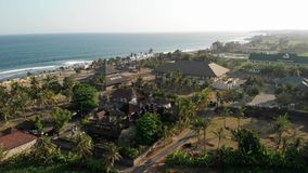 4K aerial flying drone panorama of tropical beach with black sand. Landscape panorama. Bali island stock photography