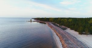 4K Aerial footage. Fly over forest coast at sunset. Aerial footage. Fly over forest coast at sunset stock video