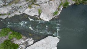 4K Aerial footage. Fly over river rapids on rocks stock video footage