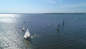 4K aerial footage. Regatta yacht sailing on river stock footage