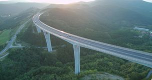 4k aerial footage of traffic over viaduct at sunset stock video