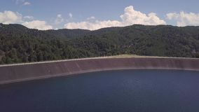 4k aerial of a fresh water lake and hydroelectric dam in Calabria, Italy stock footage