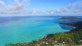 4k aerial panorama view stunning sunset seascape of Bora Bora islands French Polynesia in turquoise Pacific ocean water. Aerial panorama view stunning sunset stock footage