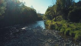 4k aerial river bend in warm sun. Aerial footage flying back to reveal the river stock video
