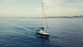 4k aerial of sailing boat in sunset cloudscape stock video