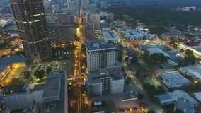 4k aerial time lapse panorama drone flight over busy urban street in Atlanta downtown in amazing bright night city light. Aerial time lapse panorama drone flight stock video footage