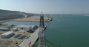 4K Aerial video filming of a container ship fixed in the port of Bautino on the shores of the Caspian Sea, Kazakhstan stock video