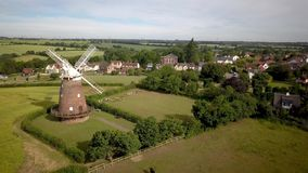 Thaxted Village and windmill, Essex, England. 4k aerial video footage rising to reveal the Essex village of Thaxted and its landmark windmill nestled in the stock footage