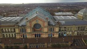 4K aerial view of Alexandra Palace with dramatic sky and clouds behind stock video footage