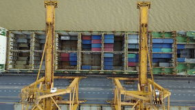 4K Aerial view of cargo ship with crane.  stock footage