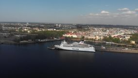 4k aerial view of cruise ship anchored on river Daguava stock footage