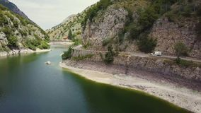4k aerial view of dam with Roman bridge ruins and mountain road, Abruzzo, Italy stock video
