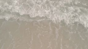 4k Aerial view Drone footage Thai Island beach with turquoise blue waves crashing against golden sands. Koh Samet Nation stock footage