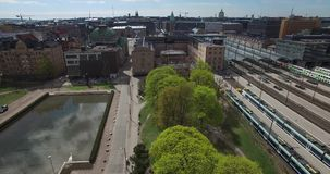 4K aerial view drone video of Helsinki garden buildings and railway tracks in Finland, northern Europe stock footage