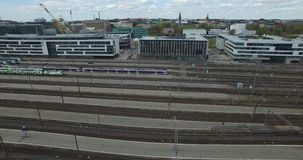 4K aerial view drone video of Helsinki garden buildings and railway tracks in Finland, northern Europe stock video