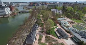 4K aerial view drone video of Helsinki garden buildings and railway tracks in Finland, northern Europe stock video footage
