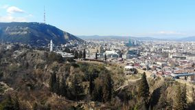 4k aerial view of funicular on hill of Tbilisi near the monument of Mother Georgia stock footage