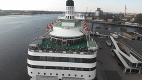 4k aerial view of open deck restaurant on cruise ship moored to the pier, Daugava river stock footage