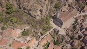 4k aerial view of Pentedattilo, church and abandoned ruins, Greek colony, Italy stock video