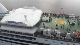 4k aerial view of people on open deck in cruise liner named Isabelle, Daugava river, Riga stock video