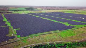 4K Aerial view of Solar Panels Farm solar cell with sunlight. Drone flight fly over solar panels field renewable green. Alternative energy concept stock footage