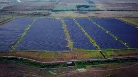 4K Aerial view of Solar Panels Farm solar cell with sunlight.Drone flight fly over solar panels field renewable green. Alternative energy concept stock footage