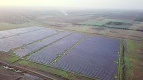 4K Aerial view of Solar Panels Farm solar cell with sunlight.Drone flight fly over solar panels field renewable green. Alternative energy concept stock video