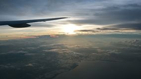 4K Aerial view of sunrise through airliner window stock video footage