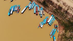 Aerial view of touristic boats viewed in Tonle-Sap lake, Siem-Reap, Cambodia. 4k Aerial view of touristic boats viewed from birdeye level in Tonle-Sap lake, Siem stock video footage