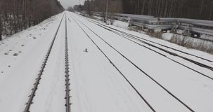 4K aerial winter view of abandoned railway near heat pipes of thermal power plant. stock footage