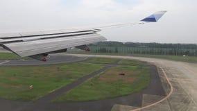4K Airplane landing at international Airport as seen through window stock video