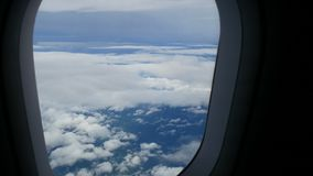 4K. airplane window view fly over cloud. passenger aircraft aviation airline flying. traveling business. transportation by air. Plane stock footage