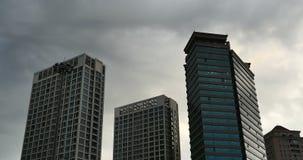4k Altocumulus clouds over CBD building high-rise&skyscraper at urban city. 4k Altocumulus clouds in sky over CBD office buildings high-rise & skyscraper at stock video