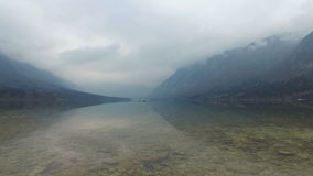 4K. Amazing Bohinj Lake in foggy weather, stones and the bird, panoramic view. Julian Alps, Triglav National Park, Slovenia. stock footage