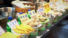 4k Asian food stand sell fried seafood in night market stock video