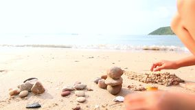 4K Asian little girl playing on the beach with evening ambient light.  stock video