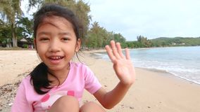 4K Asian little girl playing on the beach with evening ambient light and sound stock video