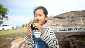 4K Asian little girl shooting video selfie in nature place.  stock video footage