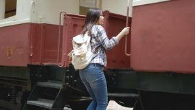 4K. Asian tourist woman waving hands to say goodbye in departe leaving train at train station. bye bye