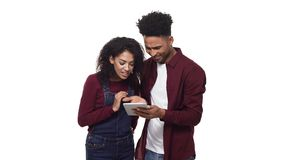 4K Attractive african american business couple talking and using tablet. 4K Attractive african american business couple talking and using tablet stock video