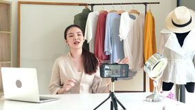 4k Attractive video of Young woman blogger recording new content for vlog maintaining video blog for a woman fashion channel